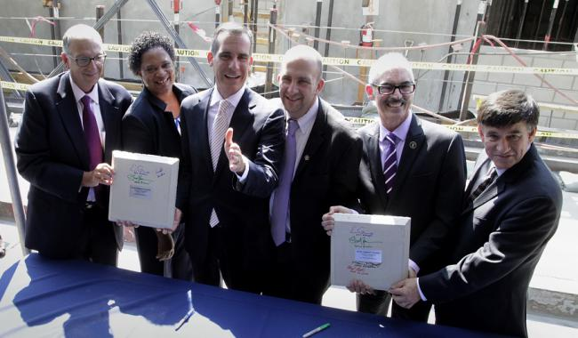 Mayor Eric Garcetti and 5 executives in a housing project topping out ceremony.